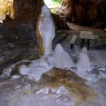image 06-stalagmite-formations-with-sunlight-coming-in-from-second-roof-collapse-window-front-view-jpg