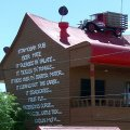 image ettamogah-pub-writing-on-right-side-of-pub-with-a-truck-on-the-roof-jpg